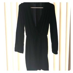 Short black long sleeve dress, low in the front.